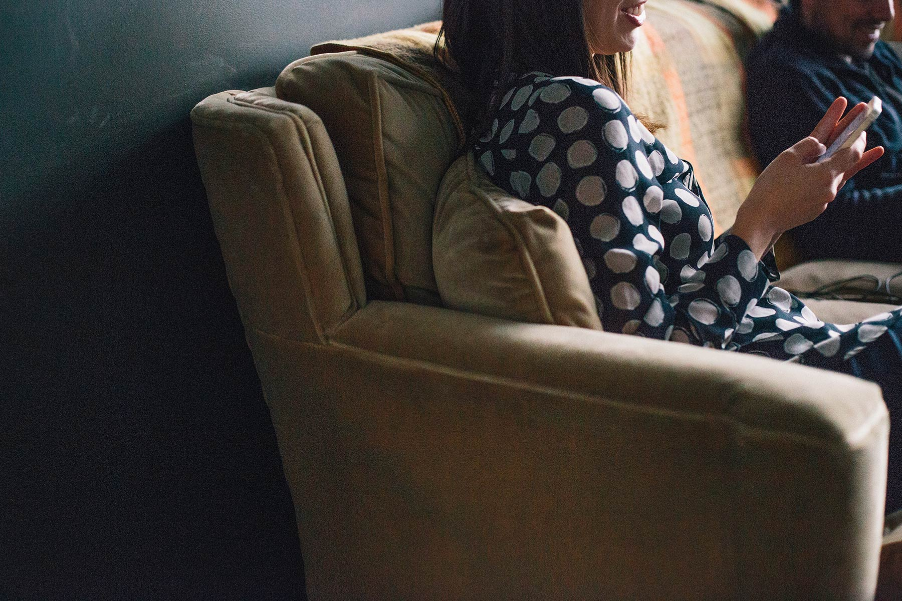 Woman working on couch